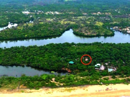 An aerial photo of the Libassa Ecolodge, located in the lower right. The red circle indicates the location of the sanctuary. (Courtesy Libassa Ecolodge)