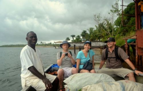 John Zeonyuway on the left, setting off from the dock with three CDC scientists to visit the chimpanzee islands. (Photo: D. Stiles)