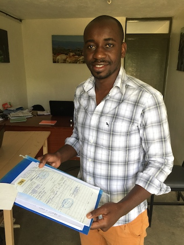 Dr. Stephen Ngulu, Sweetwaters sanctuary manager, holds the original CITES import permit for Manno. (Photo: PEGAS)