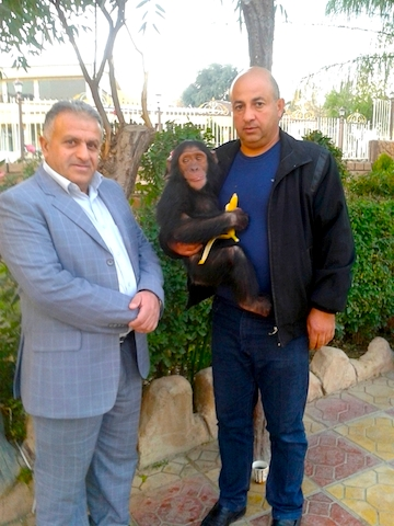 Dr. Sulaiman Tameer, on left, and Ramadan Hassan, on right, with Manno in 2014